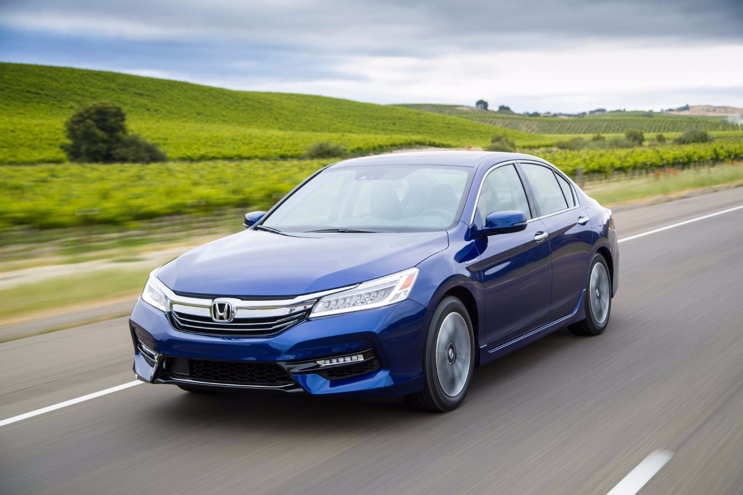 2017 Honda Accord Hybrid front three quarter in motion 02
